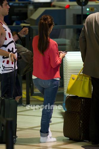 Kim Kardashian prepares to depart LAX , July 13
