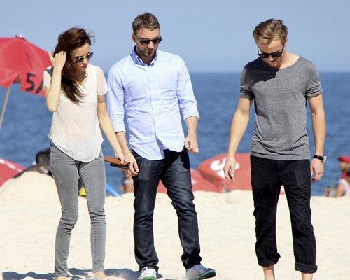 Tom Felton and girlfriend Jade Olivia strolling at the beach in Rio de Janeiro, Brazil (July 16).