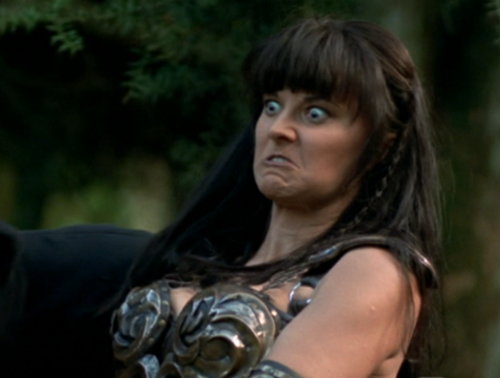 Xena paused in action. - xena-warrior-princess Photo
