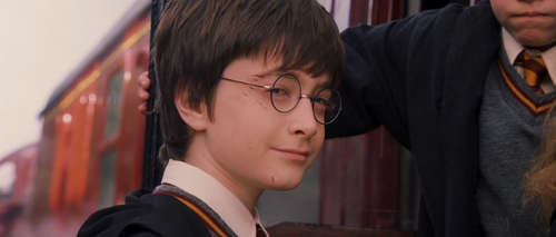 Harry Potter फिल्में वॉलपेपर containing a business suit titled Harry Potter and the Sorcerer's Stone