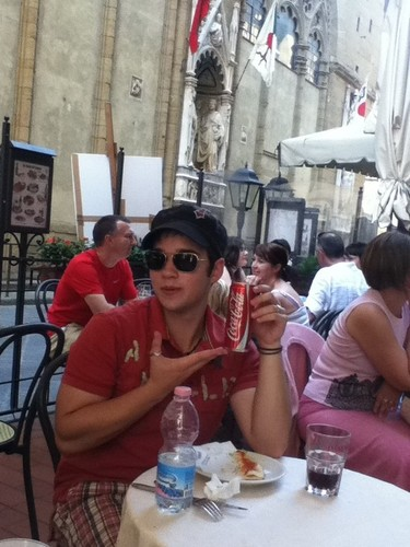 Nathan at a cafe in Firenze, Italy