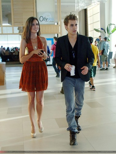Paul Wesley wallpaper with a business suit and a well dressed person entitled Paul & Torrey @ Comic Con 2011