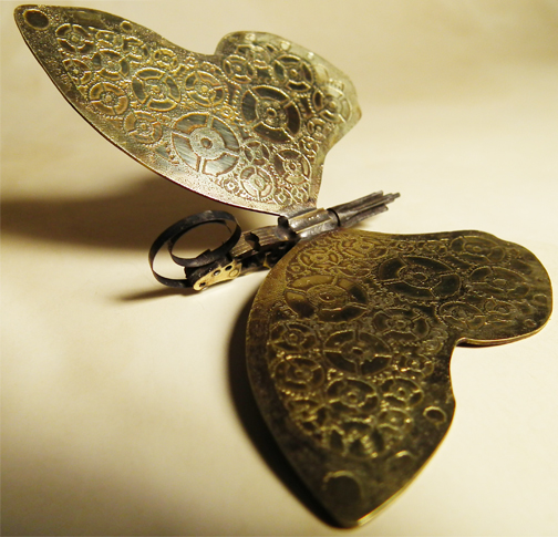 http://images4.fanpop.com/image/photos/24000000/Steampunk-Butterfly-steampunk-24069113-504-485.jpg