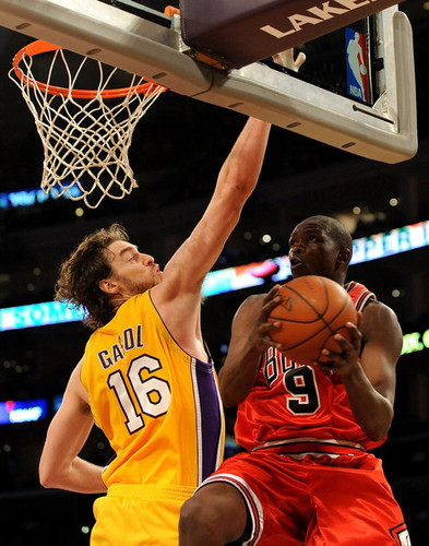 Los Angeles Lakers wallpaper with a basketball, a basketball player, and a dribbler entitled Los Angeles Lakers