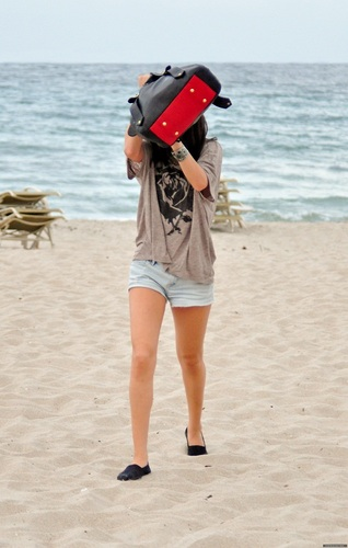 Selena - On the plage in Palm plage - July 27, 2011