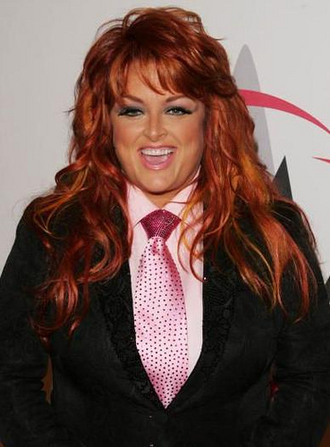 Wynonna Judd achtergrond probably containing a business suit titled Wynonna