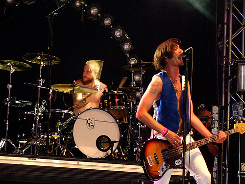 The All-American Rejects wallpaper with a guitarist and a concert titled AAR