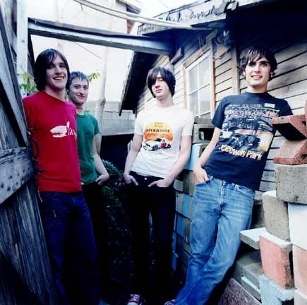 The All-American Rejects wallpaper probably with a sign, long trousers, and a street called AAR