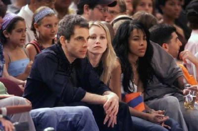Aaliyah achtergrond probably containing a business suit and a well dressed person titled Aaliyah & Damon at basketbal match