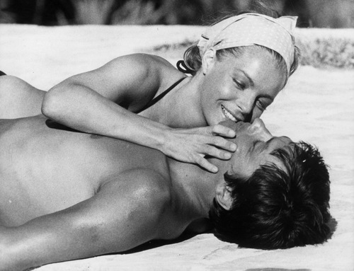 Alain Delon wallpaper probably containing skin called Alain Delon and Romy Schneider