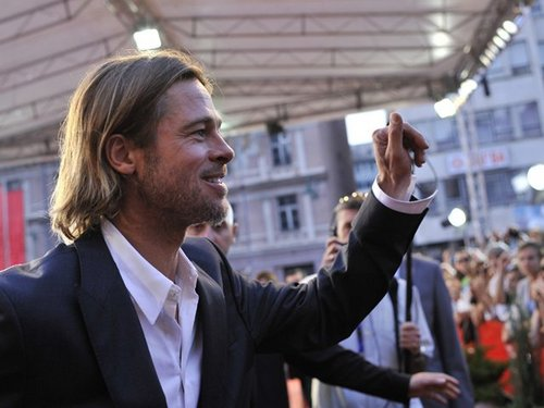 Brad Pitt wallpaper with a business suit entitled Brad Pitt In Bosina 30 july 2011