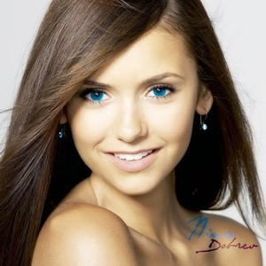 Nina with blue eyes.