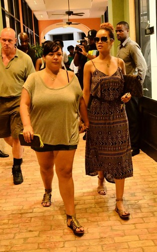 Rihanna wallpaper probably with a sign titled Rihanna spotted shopping with family and friends in Barbados (July 31).
