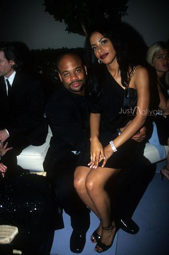 Aaliyah achtergrond possibly with bare legs, a business suit, and a hip boot entitled Vanity Fair Academy Awards Afterparty HQ Exclusive!