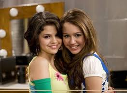 Miley Cyrus vs. Selena Gomez 바탕화면 with a portrait titled miley/selena