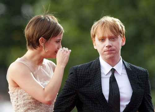 Romione wallpaper with a business suit titled rupert grint+Emma Watson