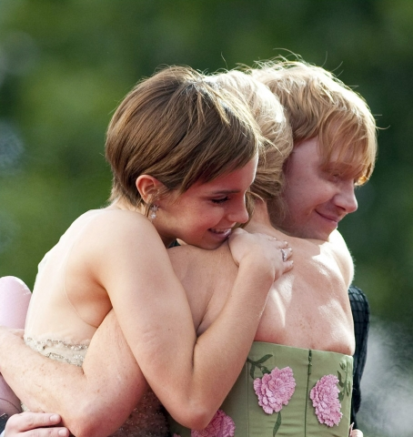 Romione wallpaper probably containing skin entitled rupert grint+Emma Watson