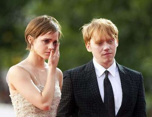 romione wallpaper possibly with a business suit titled rupert grint+Emma Watson