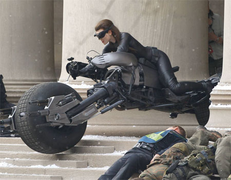 The Dark Knight Rises wallpaper possibly containing a motorcycle cop, a motorcyclist, and a rifleman called Catwoman's stunt double in action on 'DARK KNIGHT RISES' set
