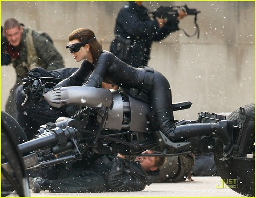 Anne Hathaway wallpaper probably containing a motorcycle cop entitled Anne Hathaway as 'Dark Knight Rises' Catwoman - FIRST LOOK!