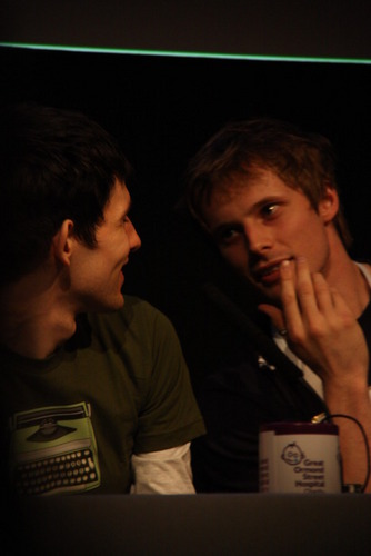 Bradley James wallpaper probably containing a laptop, a concert, and a sign called Bradley
