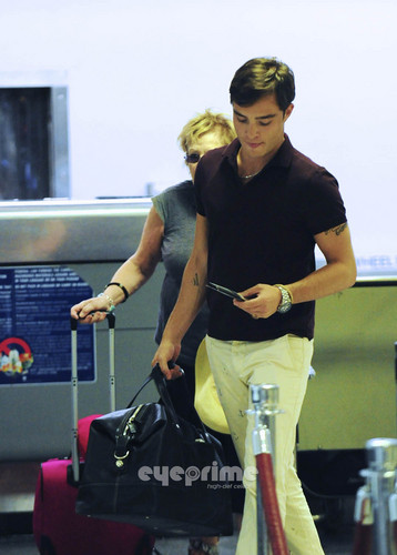 Ed Westwick And Mom Take Off From LAX, Aug 4