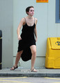 Emma Watson gives a Hell of a Zeigen outside Tesco in London, Aug 5