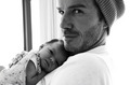 Harper Seven snuggles with daddy David Beckham in a photo posted on August 7, 2011