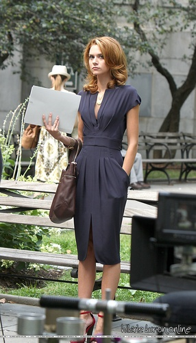 Hilarie Burton wallpaper possibly containing a well dressed person, an outerwear, and long trousers titled Hilarie Burton White Collar