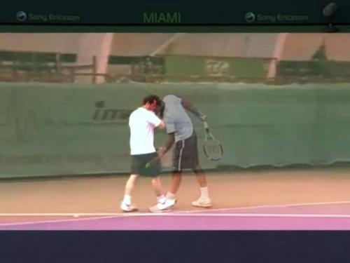 Mateasko and Federer serve
