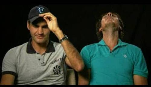 Nadal threw back his head and he about to किस Roger