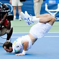 "Radek Stepanek dropped to the court and did ""The Worm"" to celebrate his stunning victory  - tennis photo"