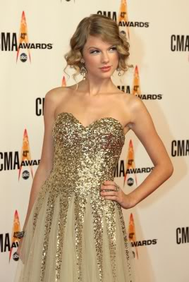 Taylor in a Gold dress