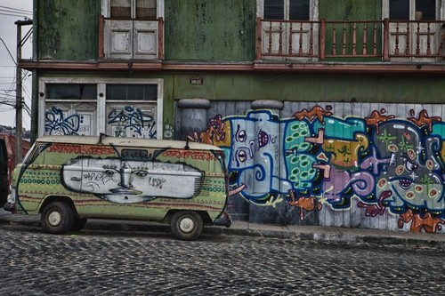 A Colorful Painted Van, Parked Von a Graffiti Painted Building