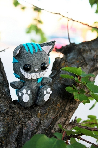 Adorable plushie of Cheshire Cat