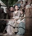 Arya and Sansa Stark with Littlefinger