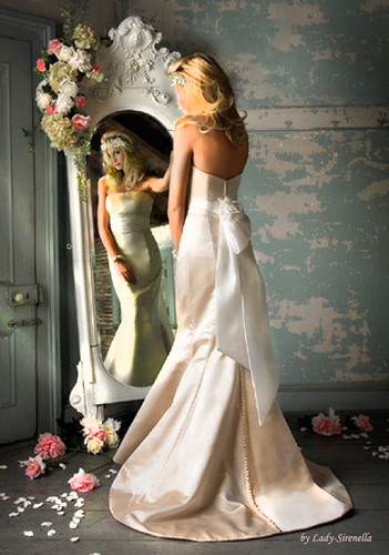 The Vampire Diaries TV Show wallpaper containing a bridesmaid, a bouquet, and a gown entitled Caroline Forbes in wedding dress