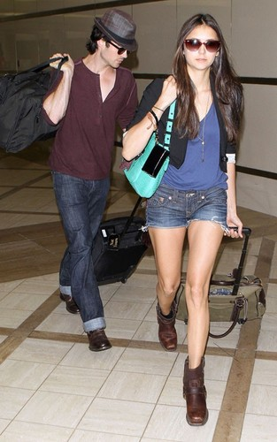 Ian Somerhalder and Nina Dobrev arriving for a flight at LAX airport in Los Angeles, CA (August 8).