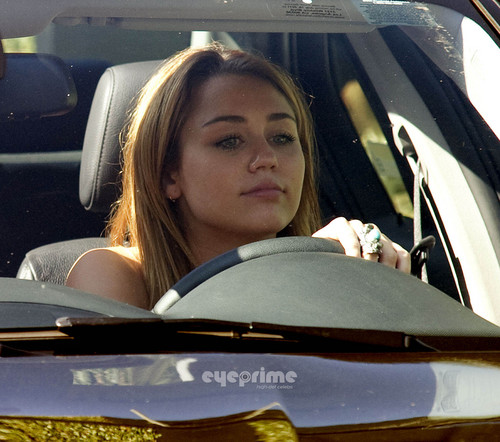 Miley Cyrus performs an illegal U-turn in West Hollywood. [August 9, 2011]