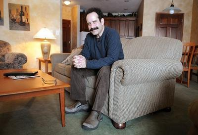 Tony Shalhoub wallpaper with a living room, a family room, and a den called Tony