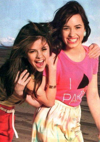 Selena Gomez and Demi Lovato wallpaper probably containing a nightwear, a playsuit, and a top titled delena govato :)