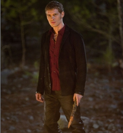 red shirt and brown pants