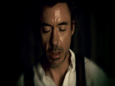 Robert Downey Jr. has some non-English dialogue in the Sherlock Holmes movie?What language did he speak?
