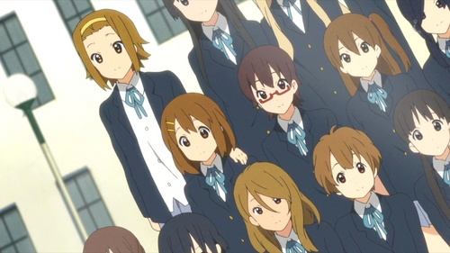 (S2)In EP26, the HTT seniors and Sawa-chan look at the new yearbook. They all freak when they see Ritsu's hand on Yui's shoulder in the class pic. Why is this?