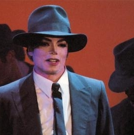 When he was a teenager, Michael had posters on his walls with_____