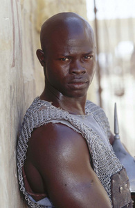 What was Juba's prefession before he was enslaved?