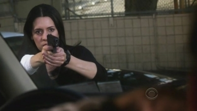 In 5x11 Retaliation, Emily shoots the unsub when he points a gun at: