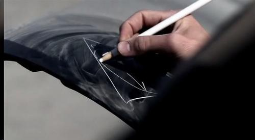 What did Sam draw on the Impala's トランク and why?