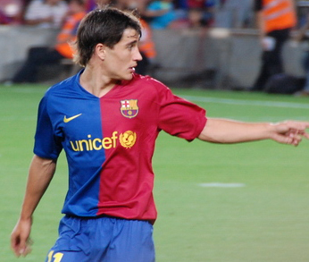 When did he make his official debut for Barcelona?
