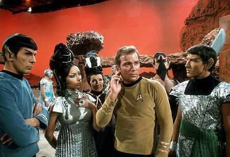 By fighting T'pring's chosen champion Spock accomplishes what?